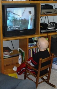 Andrew watches the Sabbath School program from home when his white blood cell counts were too low to attend in person.